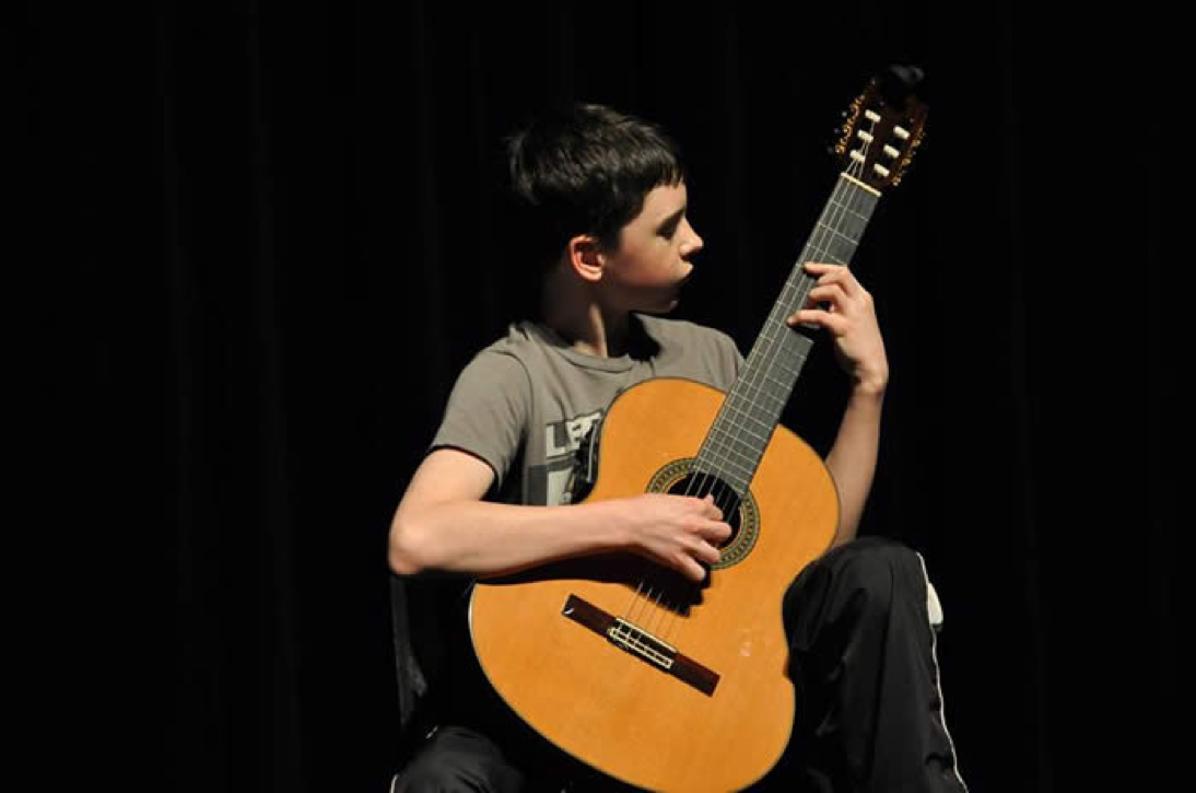 a boy playing guitar