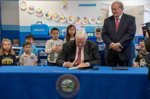 Governor Justice signing a proclamation