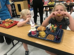 Child enjoys lunch at the Summer Food Service Program Kickoff